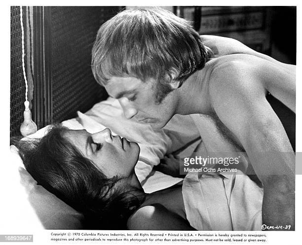 Samantha Eggar lies in bed with John McEnery in a scene from the film 'The Lady In The Car With Glasses And A Gun' 1970