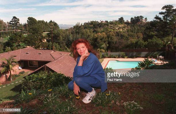 Samantha Eggar poses in her garden February 7 1996 in Bel Air California