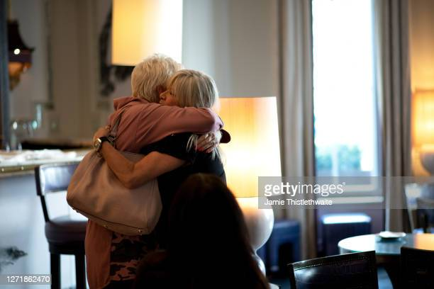 Samantha Fox and Denise Welch hug during the Henpire podcast launch event at Langham Hotel on September 10 2020 in London England
