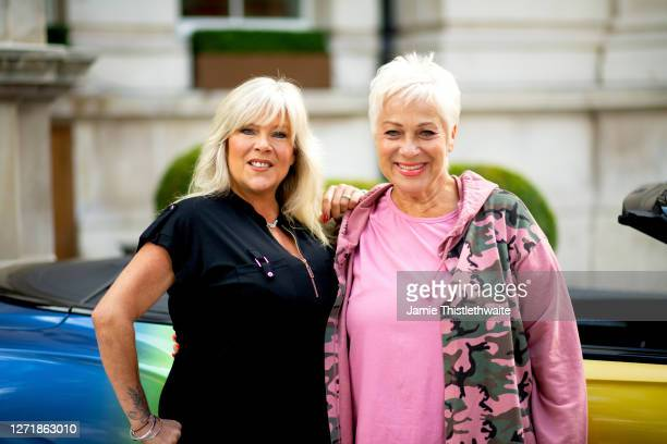 Samantha Fox and Denise Welch pose with the rainbow Bentley during the Henpire podcast launch event at Langham Hotel on September 10 2020 in London...