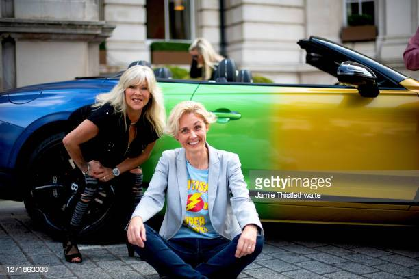 Samantha Fox and Samantha Grierson pose with the rainbow Bentley during the Henpire podcast launch event at Langham Hotel on September 10 2020 in...