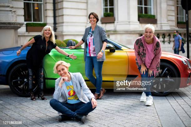 Samantha Fox Denise Welch Heather Peace and Samantha Grierson pose with the rainbow Bentley during the Henpire podcast launch event at Langham Hotel...