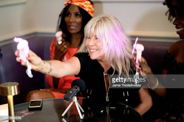 Samantha Fox poses with a neon mini fan during the Henpire podcast launch event at Langham Hotel on September 10 2020 in London England