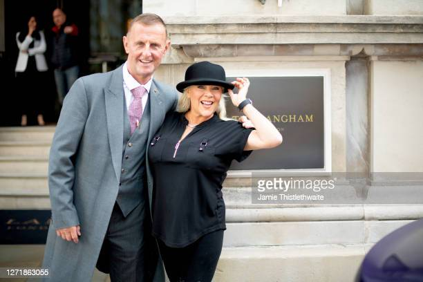 Samantha Fox poses with The Langham doorman during the Henpire podcast launch event at Langham Hotel on September 10 2020 in London England