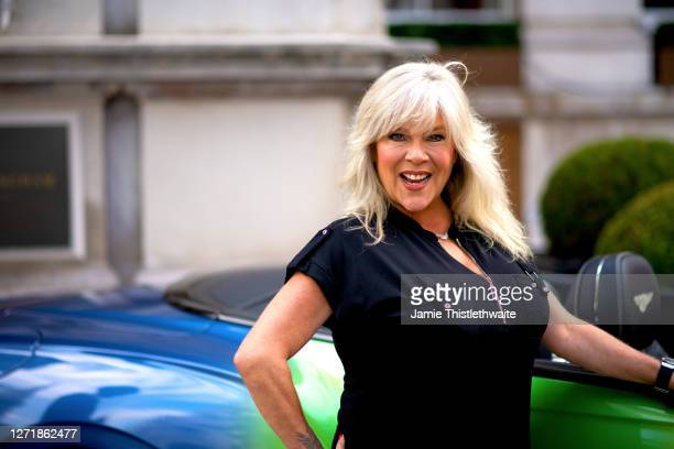 Samantha Fox poses with the rainbow Bentley during the Henpire podcast launch event at Langham Hotel on September 10 2020 in London England