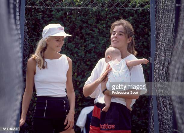 Samantha Frankel girlfriend of tennis player Ivan Lendl holding their first daughter Marika during the Stella Artois Championships at the Queen's...
