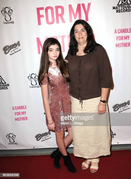 Samantha Gangal poses with her mother Kendra Gangal at a luncheon in honor of Mother's Day for the release of Pamela L Newton's 'A Candle For My...