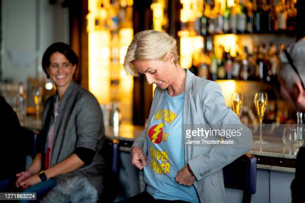 """Samantha Grierson shows off her t-shirt to the audience on the Cast and Crew panel during the """"Henpire"""" podcast launch event at Langham Hotel on..."""