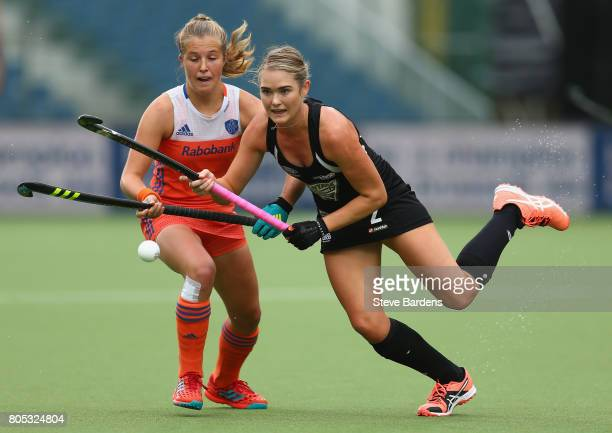 Samantha Harrison of New Zealand breaks away from Xan de Waard of the Netherlands during the Fintro Hockey World League semi final game between the...