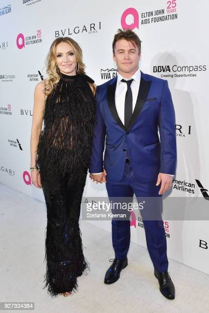 Samantha Hemsworth and Luke Hemsworth attend the 26th annual Elton John AIDS Foundation Academy Awards Viewing Party sponsored by Bulgari,...