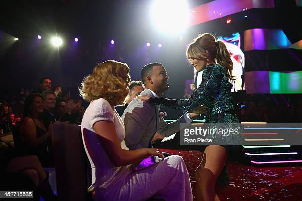 Samantha Jade embraces Guy Sebastian as she is announced as winner of the award for 'Song of the Year' during the 27th Annual ARIA Awards 2013 at the...