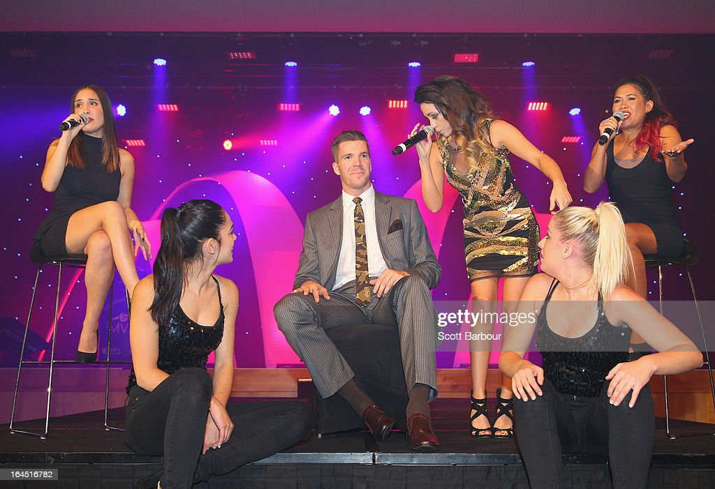 Samantha Jade performs with on stage with Lucas Walker of the Melbourne Tigers during the 2013 Basketball Australia MVP Awards at Crown Palladium on March 24, 2013 in Melbourne, Australia.