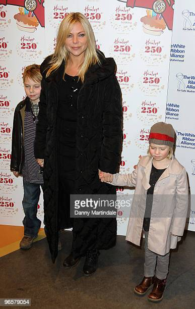 Samantha Janus and children attend the 250th Birthday Party of Hamleys at Hamleys on February 11 2010 in London England