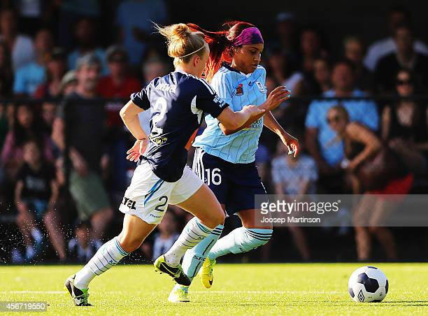 Samantha Johnson of Sydney FC competes with Hannah Brewer of the Victory during the round four WLeague match between Sydney and Melbourne at Lambert...