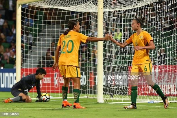 Samantha Kerr and Chloe Logarzo of the Matildas celebrate a goal during the International Friendly Match between the Australian Matildas and Thailand...