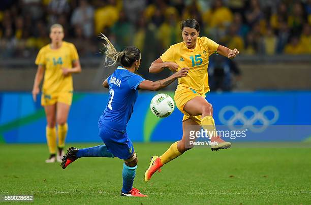 Samantha Kerr of Australia battles for the ball against Fabiana of Brazil in the first half during the Women's Football Quarterfinal match at...