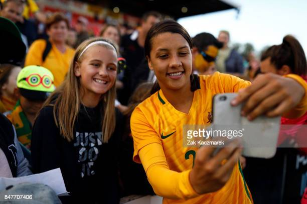 Samantha Kerr of Australia takes selfies with fans after Australia defeate Brazil 21 during the women's international match between the Australian...