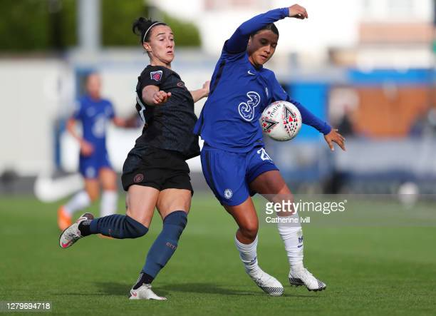 Samantha Kerr of Chelsea battles for possession with Lucy Bronze of Manchester City during the Barclays FA Women's Super League match between Chelsea...