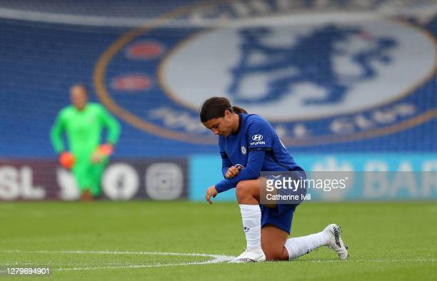 Samantha Kerr of Chelsea takes a knee in support of the Black Lives Matter movement ahead of the Barclays FA Women's Super League match between...