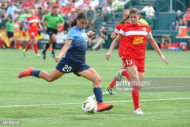 Samantha Kerr of Sky Blue FC takes a shot around Brittany Taylor of Western New York Flash during the first half at Sahlen's Stadium on July 19 2015...