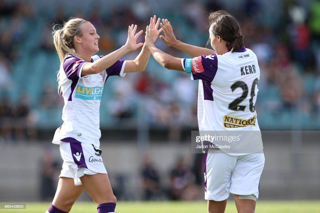 Samantha Kerr of the Glory celebrates with Rachel Hill after scoring a goal during the round six W-League match between the Western Sydney Wanderers and the Perth Glory at Marconi Stadium on December 1, 2017 in Sydney, Australia.