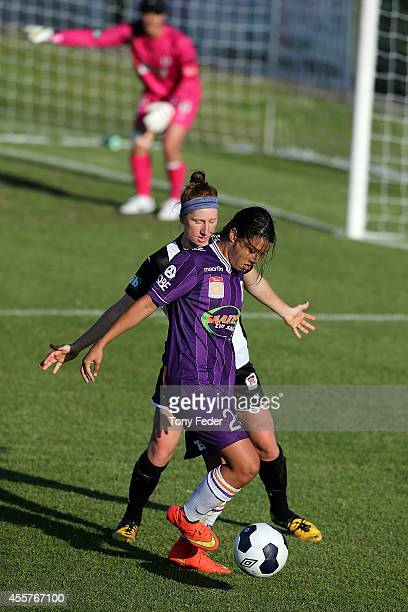 Samantha Kerr of the Glory controls the ball in front of Ashley Spina of the Jets during the round two WLeague match between the Newcastle Jets and...
