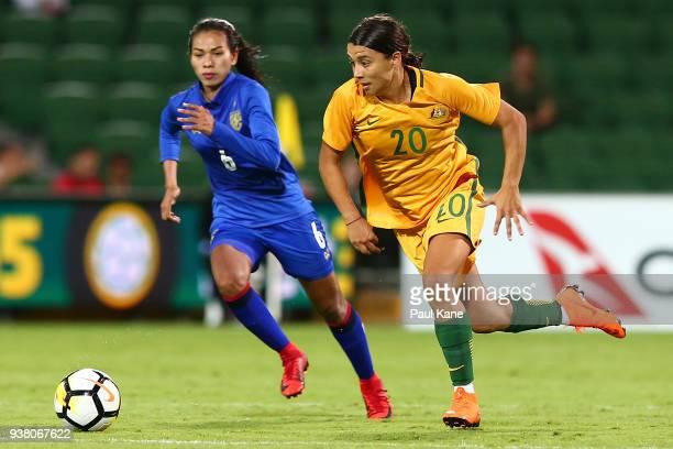 Samantha Kerr of the Matildas runs onto the ball against Pikul Khueanpet of Thailand during the International Friendly Match between the Australian...
