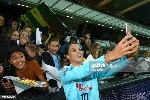 Samantha Kerr of the Matildas takes selfies for spectators following the International Friendly Match between the Australian Matildas and Thailand at...