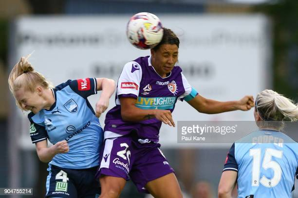 Samantha Kerr of the Perth Glory heads the ball against Elizabeth Ralston of Sydney during the round 11 WLeague match between the Perth Glory and...