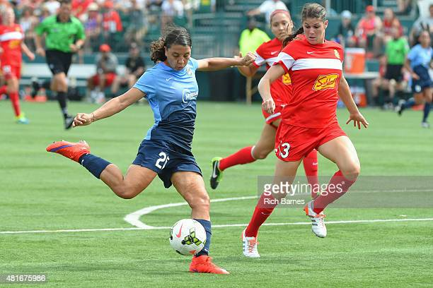 Samantha Kerr of the Sky Blue FC shoots the ball around Brittany Taylor of the Western New York Flash during the first half at Sahlen's Stadium on...