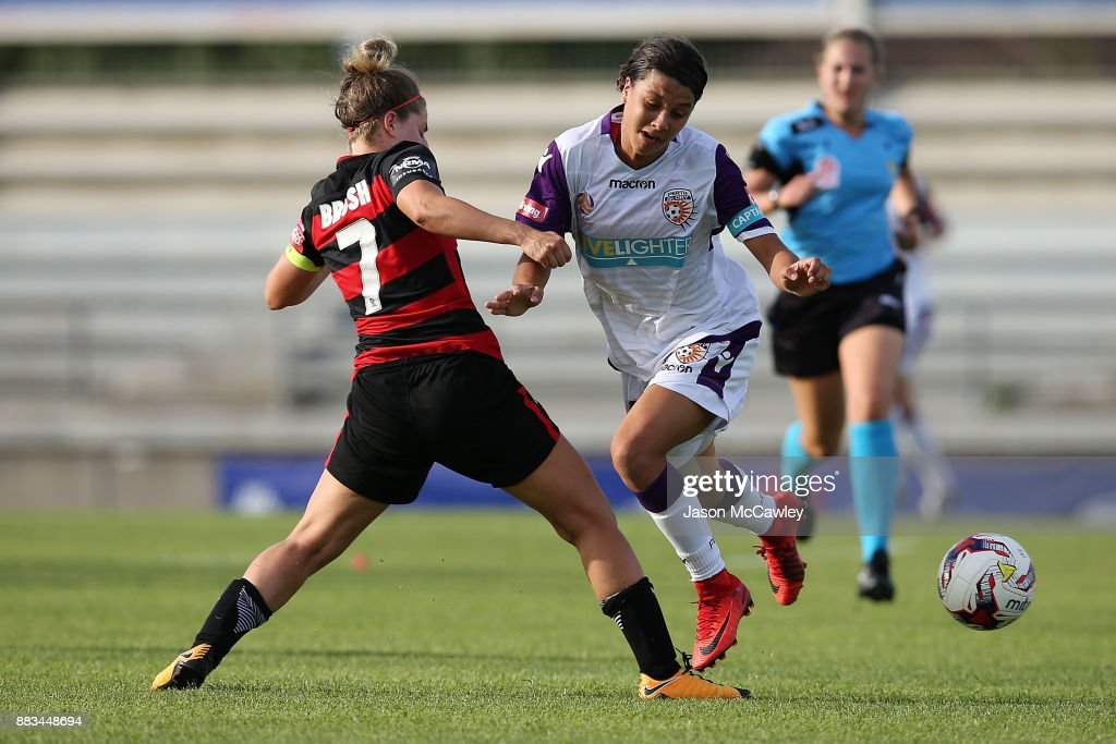 Samantha Kerr of the Wanderers is challenged by Ellie Brush of the Wanderers during the round six W-League match between the Western Sydney Wanderers and the Perth Glory at Marconi Stadium on December 1, 2017 in Sydney, Australia.