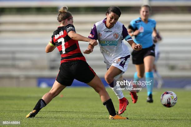 Samantha Kerr of the Wanderers is challenged by Ellie Brush of the Wanderers during the round six WLeague match between the Western Sydney Wanderers...