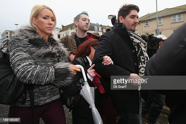Samantha Kidd the estranged wife of former stuntman Eddie Kidd is shielded from view by friends as she leaves Brighton Magistrates Court charged with...