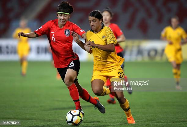 Samantha May Kerr of Australia and Lim Seon Joo of Korea Republic battle for the ball during the AFC Women's Asian Cup Group B match between...