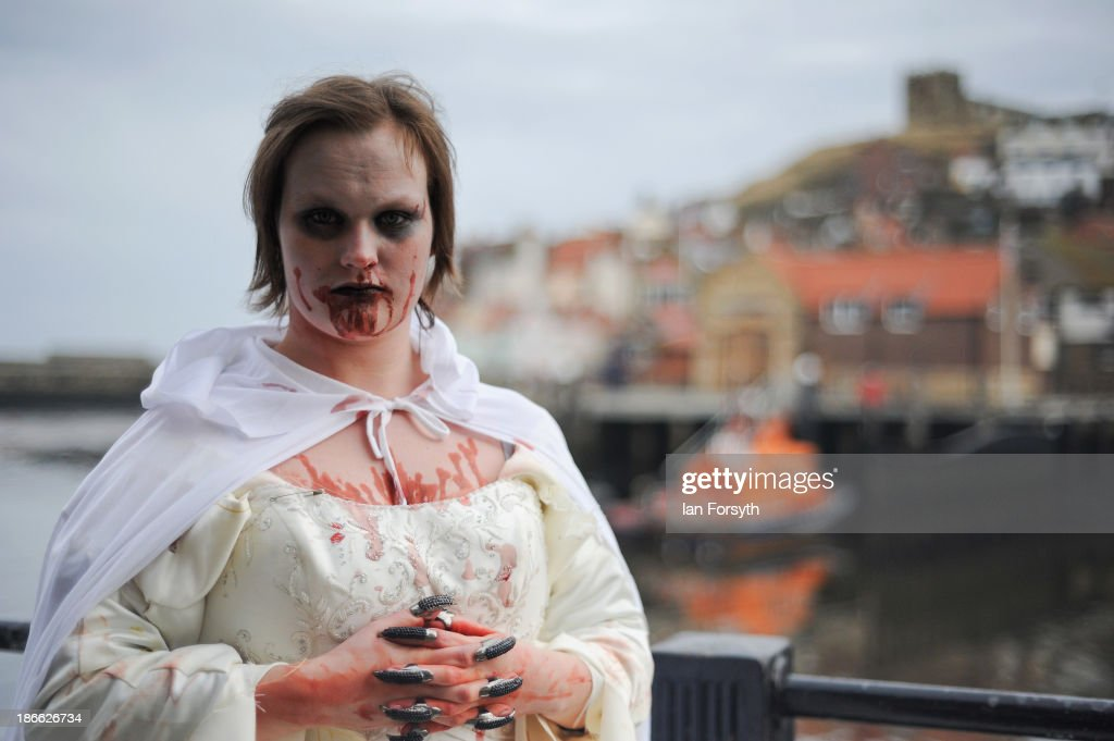 Samantha Mercado, 22 a waitress from York takes part in the Goth weekend on November 2, 2013 in Whitby, England. The Whitby Gothic Weekend that takes place in the Yorkshire seaside town twice yearly in Spring and Autumn started in 1994 and sees thousands of extravagantly dressed followers of Victoriana, Steampunk, Cybergoth and Romanticism visit to take part in celebrating Gothic culture.