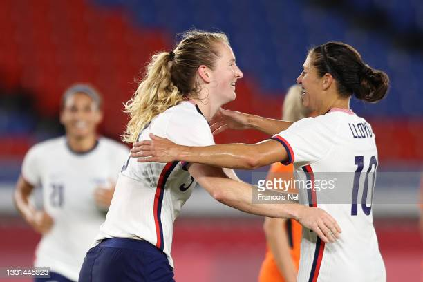 Samantha Mewis of Team United States celebrates with Carli Lloyd after scoring their side's first goal during the Women's Quarter Final match between...