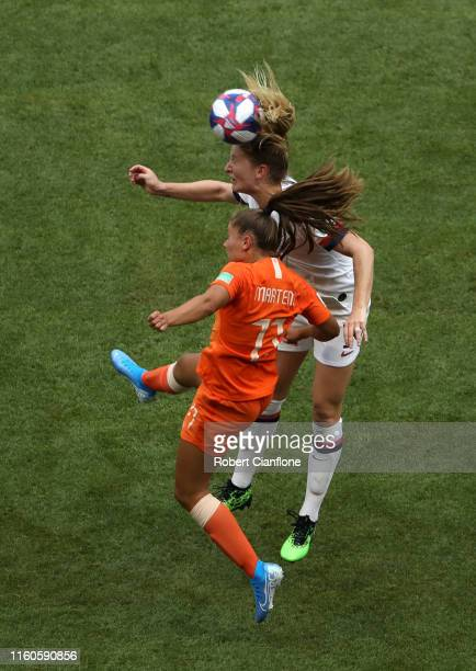Samantha Mewis of the USA competes for a header with Lieke Martens of the Netherlands during the 2019 FIFA Women's World Cup France Final match...