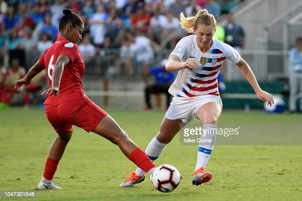 Samantha Mewis of the USA slips past Aldrith Quintero of Panama during the soccer game at WakeMed Soccer Park on October 7 2018 in Cary North Carolina