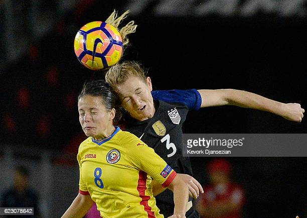 Samantha Mewis of United States goes for a header against Stefania Vatafu of Romania during the second half of their international friendly soccer...