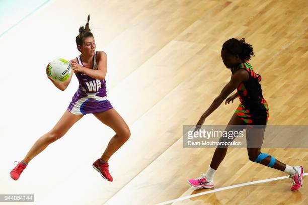 Samantha Murphy of Scotland battles for the ball with Takondwa Lwazi of Malawi during Netball on day six of the Gold Coast 2018 Commonwealth Games at...