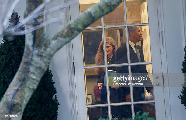 Samantha Power a senior director at the Office of Multilateral Affairs and Human Rights walks past US President Barack Obama after a meeting in the...