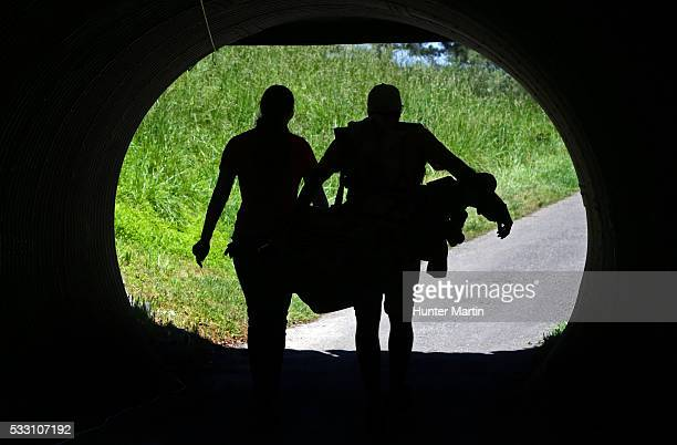 Samantha Richdale of Canada and her caddie walk through an under pass on their way to the ninth tee during the second round of the Kingsmill...