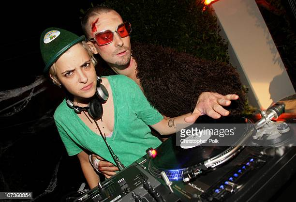 DJ Samantha Ronson and Musician Adam Levine attend Maroon 5's Halloween Party sponsored by Bacardi on October 31 2007 in Los Angeles California