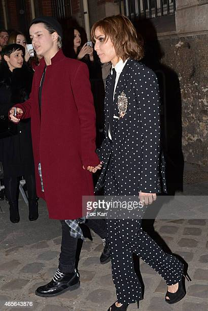 Samantha Ronson and Noomi Rapace attend the Givenchy show as part of the Paris Fashion Week Womenswear Fall/Winter 2015/2016 on March 8 2015 in Paris...