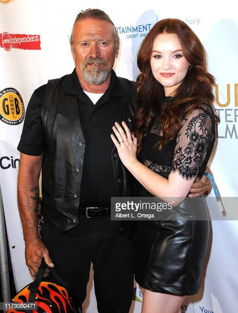 Samantha Rose Baldwin and father Michael Baldwin attend the Premiere Of Relish At The Burbank International Film Festival held at AMC Burbank 16 on...