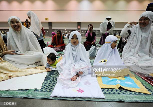 Samantha Sarwono and her daughters Yasyaa and Mutiara Sarwono Muslims from Indonesia gather with fellow Muslims for a special Eid ulFitr morning...