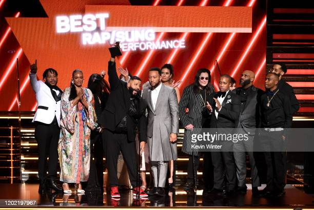 Samantha Smith Lauren London and John Legend accept the Best Rap/Sung Performance award for 'Higher' onstage during the 62nd Annual GRAMMY Awards at...