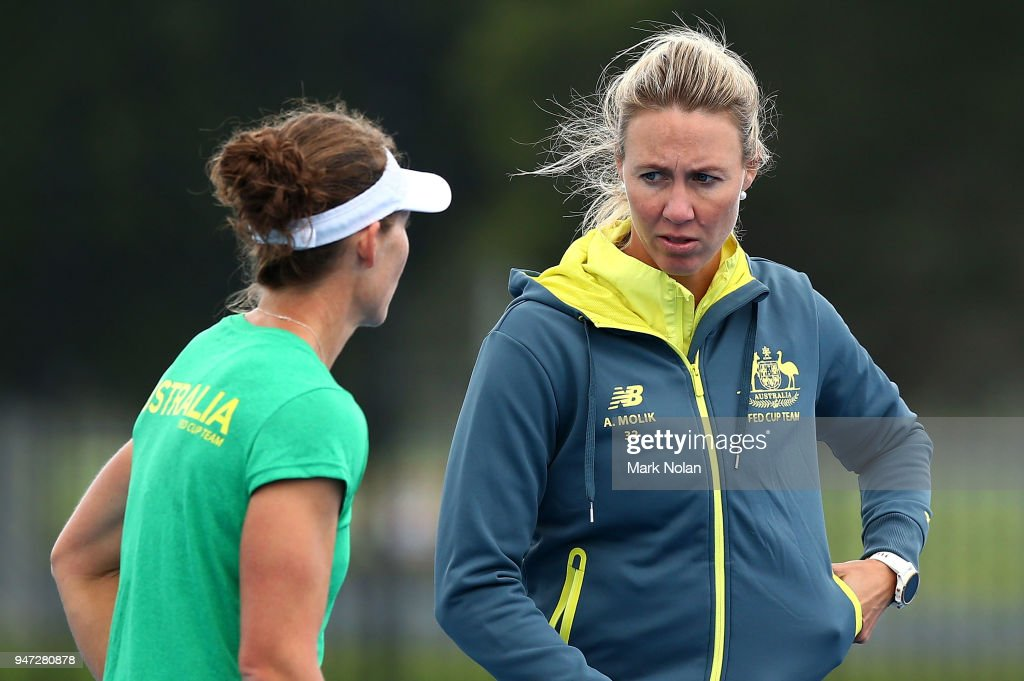 Samantha Stosur and Alicia Molik chat during a media opportunity ahead of the Australia v Netherlands Fed Cup World Group Play-off at Wollongong Tennis Club on April 17, 2018 in Wollongong, Australia.