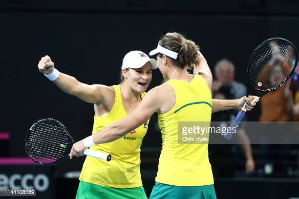Samantha Stosur and Ashleigh Barty of Australia celebrate winning their doubles match against Victoria Azarenka and Aryna Sabalenka of Belarus during...