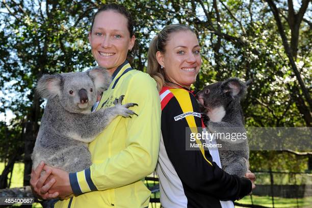 Samantha Stosur of Australia and Angelique Kerber of Germany pose for a photograph holding a koala during the official draw ahead of the Fed Cup Semi...